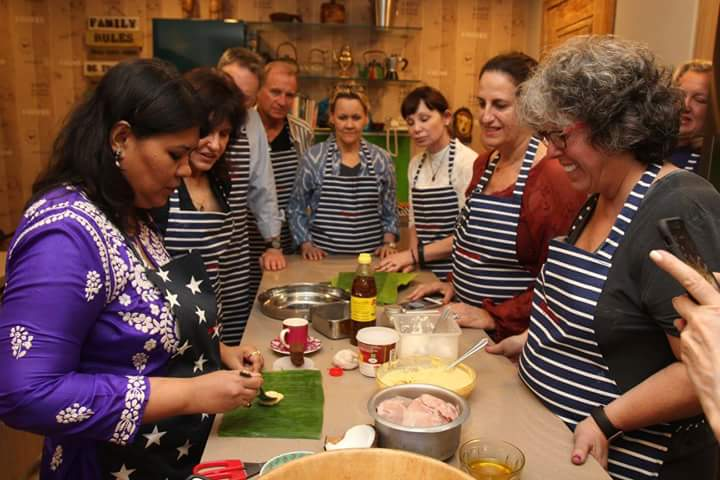 Cook along with chef Akasha Richmond and group